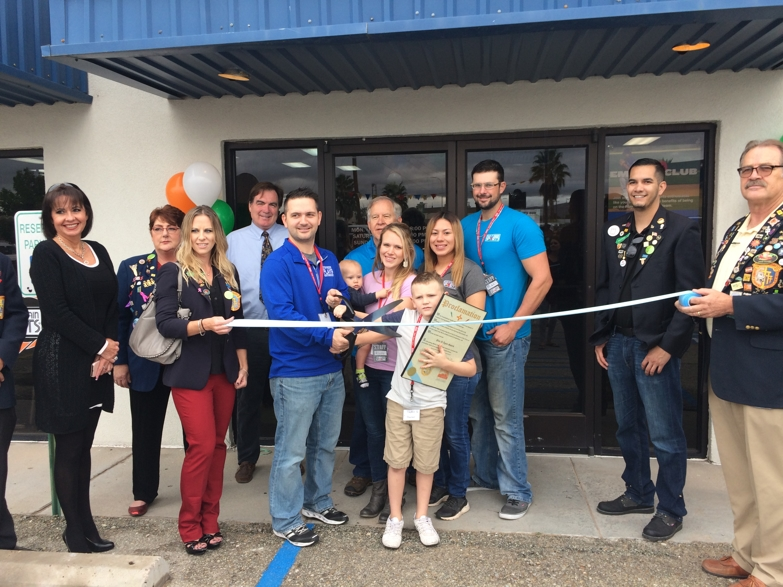 Ribbon cutting ceremony for new franchisees, Justin and Alysha