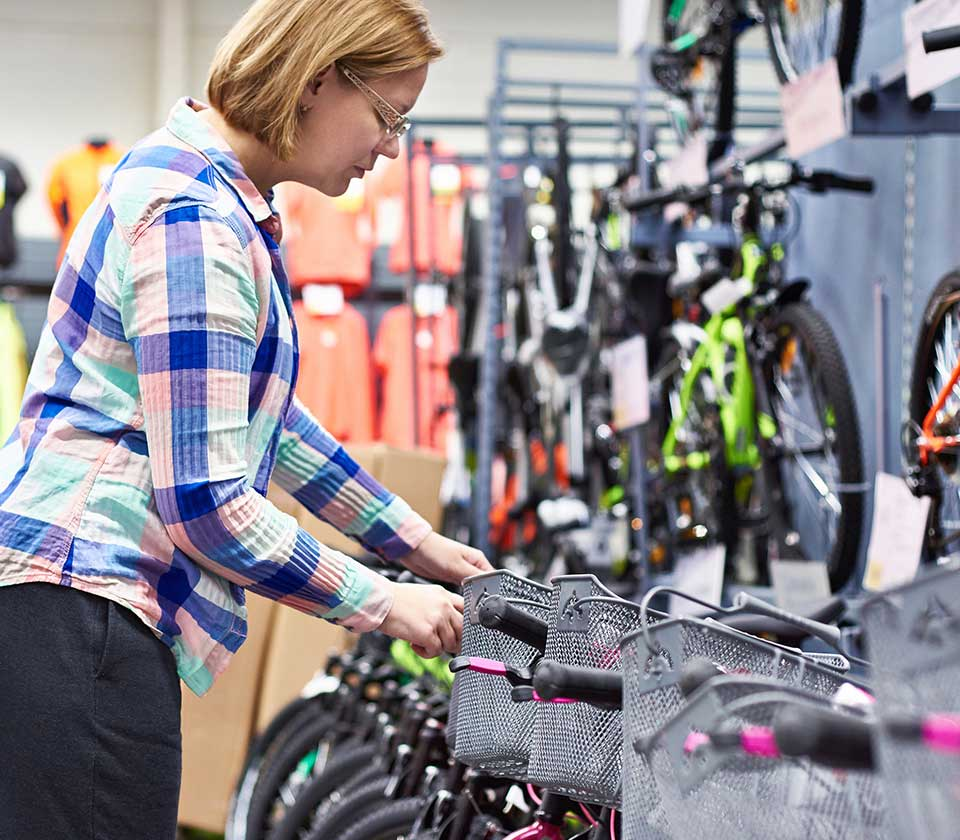 Woman looking at bikes in sports store