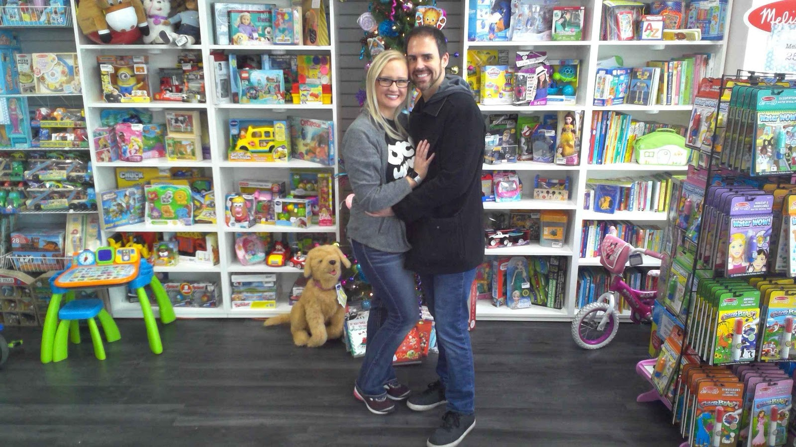 two people hugging in toy store
